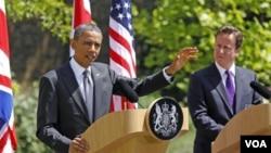 Presiden AS, Barack Obama dan PM Inggris David Cameron dalam konferensi pers bersama di London (25/5).