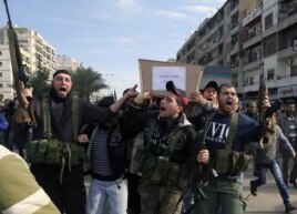 Lebanese Islamist gunmen fire their weapons as three bodies of other members of their group arrive from Syria, in Tripoli in northern Lebanon, December 9, 2012.