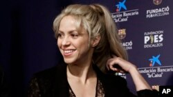 FILE - Colombian singer Shakira smiles before a press conference for a charity event at the Camp Nou stadium in Barcelona, Spain.