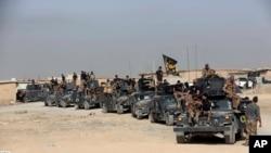 Pasukan elit Irak berkumpul menjelang operasi merebut kembali Mosul yang dikuasai ISIS di luar kota Erbil, Irak, 15 Oktober 2016 (AP Photo/Khalid Mohammed, File).