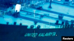 A image from video taken by the U.S. Coast Guard shows the oil tanker United Kalavyrta (also known as the United Kalavrvta), which is carrying a cargo of disputed Kurdish crude oil, approaching Galveston, Texas, July 25, 2014.