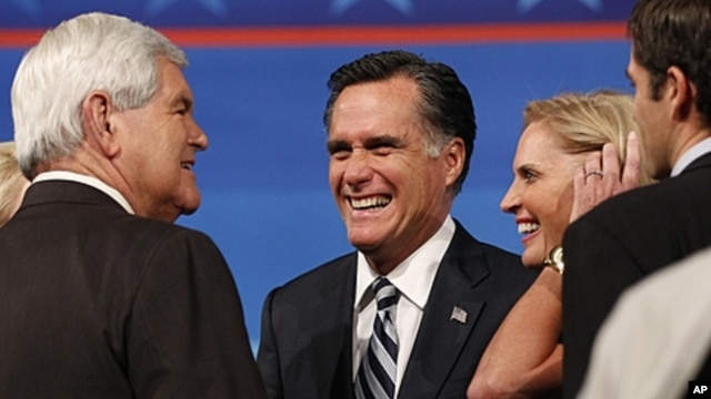 Former Mass. Governor Romney, wife talk to former Speaker of the U.S. House of Representatives Newt Gingrich in Orlando, Sept. 23, 2011.