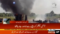 In this image taken from video, black smoke rises from oil tanker on road in Bahawalpur, Pakistan, June 25, 2017.