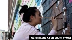 Amanda Phingbodhipakkiya, a multidisiciplinary artist based in Brooklyn, New York, painted a mural in Washington, D.C. in May, 2021.