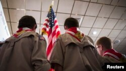 FILE - Boy Scouts stand on stage with a U.S. flag during the Pledge of Allegiance to begin the inaugural Freedom Summit meeting for conservative speakers in Manchester, New Hampshire, April 12, 2014.