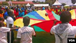 Children with disabilities at play in a rehabilitation center known as CoRSU (Comprehensive Rehabilitation Services for Uganda), Kampala, Uganda, Nov. 13, 2014. (Elizabeth Paulat/VOA)
