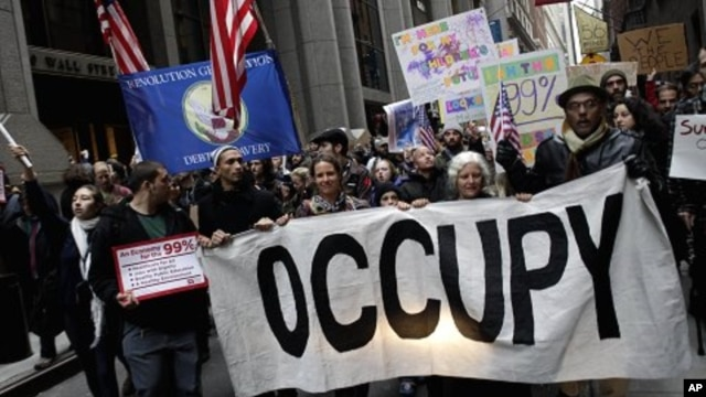 Occupy Wall Street protesters march through lower Manhattan in New York, Thursday, Nov. 17, 2011. Two days after the encampment that sparked the global Occupy protest movement was cleared by authorities, demonstrators marched through New York's financial