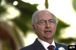 FILE - Venezuelan opposition leader and former Caracas Mayor Antonio Ledezma addresses the press in Washington, Nov. 28, 2017.