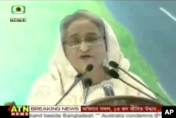 In this image from video provided by ATN News, Bangladesh's Prime Minister Sheikh Hasina delivers a speech regarding the militant hostage-taking at a restaurant in Dhaka, July 2, 2016. Hasina condemned the attack, which was claimed by the Islamic State gr