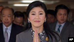 FILE - Thai Prime Minister Yingluck Shinawatra arriving at the office of Permanent Secretary for Defense on the outskirts of Bangkok, Thailand, Friday, Jan. 17, 2014.