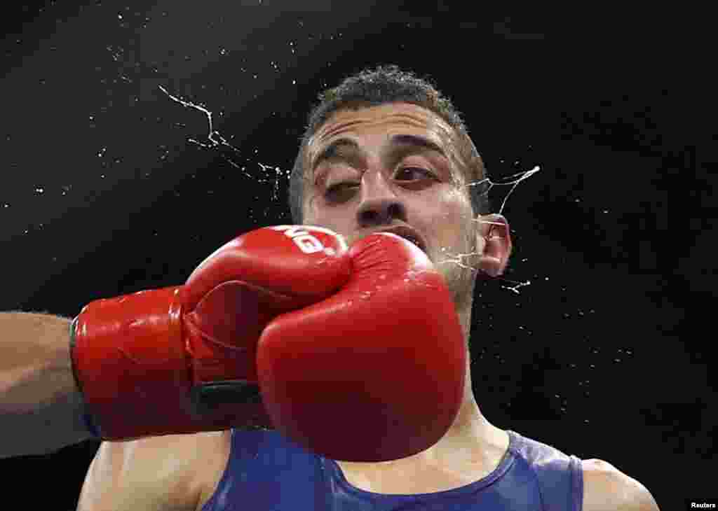 Mohamed Flissi of Algeria competes in a preliminary boxing match at the Olympics in Rio de Janeiro, Brazil.