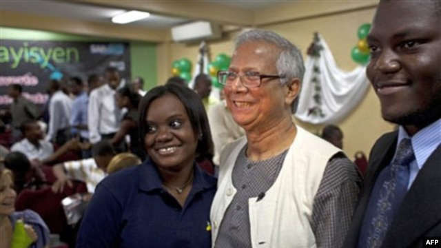 Muhammad Yunus has his picture taken with students at a technical school in Port-au-Prince, Haiti last year.  The school received a loan from a group headed by Mr. Yunus to help build social businesses.