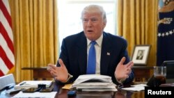 FILE - President Donald Trump is seen giving an interview in the Oval Office at the White House in Washington, Feb. 23, 2017.