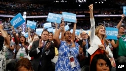 New York delegates cheer during the second day session of the Democratic National Convention in Philadelphia, July 26, 2016.