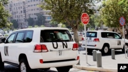 Vehículos de la ONU en las calles de Damasco; En Sriria se usó gas sarín.