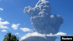 The Chaparrastique volcano spews ash in the municipality of San Miguel, El Salvador, Dec. 29, 2013.
