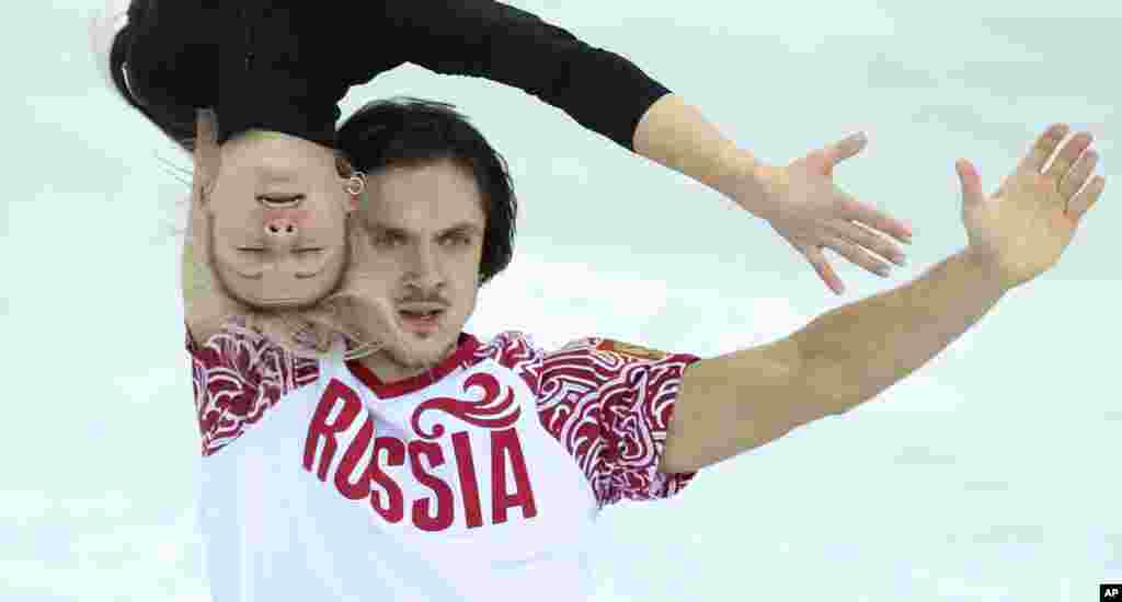 Russia's Tatiana Volosozhar and Maxim Trankov practice their routine at the figure stating practice rink ahead of the 2014 Winter Olympics, Feb. 5, 2014.