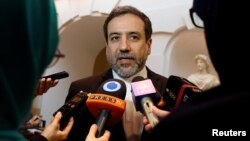 FILE - Iran's top nuclear negotiator, Abbas Araqchi, talks to journalists in Vienna, Austria, Oct. 19, 2015.