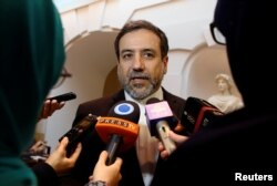 FILE - Iran's top nuclear negotiator, Abbas Araqchi, talks to journalists after meeting senior officials from the United States, Russia, China, Britain, Germany and France in a hotel in Vienna, Austria, Oct. 19, 2015.
