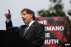 "Rep. Jamie Raskin, D-Md., speaks to demonstrators gathered near the Washington Monument during the ""March for Truth,"" June 3, 2017, in Washington, D.C."