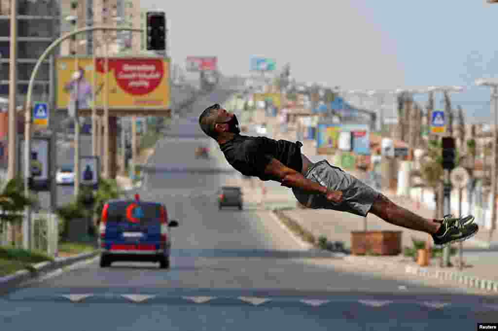 Palestinian athlete Ahmed Abu Hasira demonstrates his parkour skills during the COVID-19 lockdown in Gaza City.