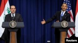 奥巴马和马利基在记者会上。