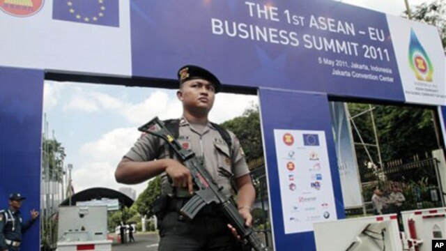 An armed police officer stands guard outside the venue of the 18th ASEAN Summit  - will be held on May 7-8 in Jakarta, Indonesia, May 4, 2011