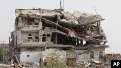 A view of a building destroyed by a Saudi-led air strike is seen in Haradh city of Yemen's northwestern province of Hajja May 20, 2015.