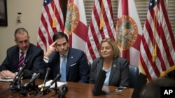 Sen. Marco Rubio, R-Fla., center, is joined by Rep. Mario Diaz-Balart, R-Fla., left, and Rep. Ileana Ros-Lehtinen, R-Fla., as they speak with a Venezuelan opposition leader via speakerphone on Capitol Hill in Washington, July 28, 2017.