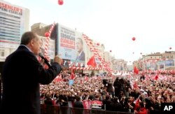 FILE - Turkey's President Recep Tayyip Erdogan addresses his supporters during a rally in Istanbul, March 26, 2017.