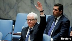 Russian Ambassador Vitaly Churkin vetoes a draft resolution that demanded an immediate end to airstrikes and military flights over Aleppo, Syria, at U.N. Headquarters in New York, Oct. 8, 2016.