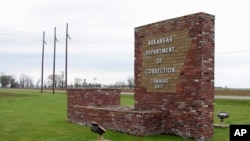 This March 25, 2017, file photo shows a sign for the Department of Correction's Cummins Unit prison in Varner, Ark.