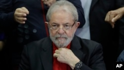 FILE - In this July 13, 2017, photo, former Brazilian President Luiz Inacio Lula da Silva prepares to speak to the press and supporters at the headquarters of the Worker's Party, in Sao Paulo, Brazil.