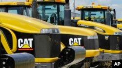 FILE - Earth-moving tractors and equipment made by Peoria, Illinois-based Caterpillar Inc. are seen in Clinton, Illinois, June 20, 2012.