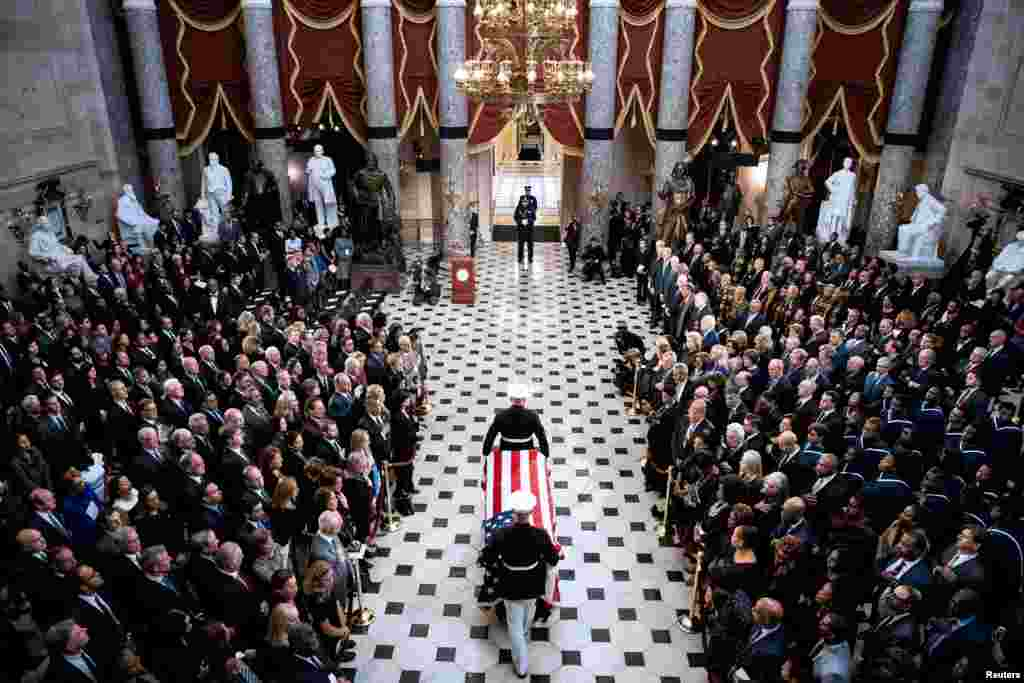 The flag-draped casket of late U.S. Representative Elijah Cummings (D-MD) is carried through National Statuary Hall during a memorial service at the U.S. Capitol in Washington.