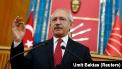 FILE - Turkey's main opposition Republican People's Party (CHP) Leader Kemal Kilicdaroglu addresses his party MPs during a meeting at the Turkish parliament in Ankara.