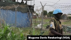 A U.N. peacekeeper stands guard at the U.N. Mission in South Sudan base in Malakal, where some 19,000 people have been sheltering in this 2014 file photo.
