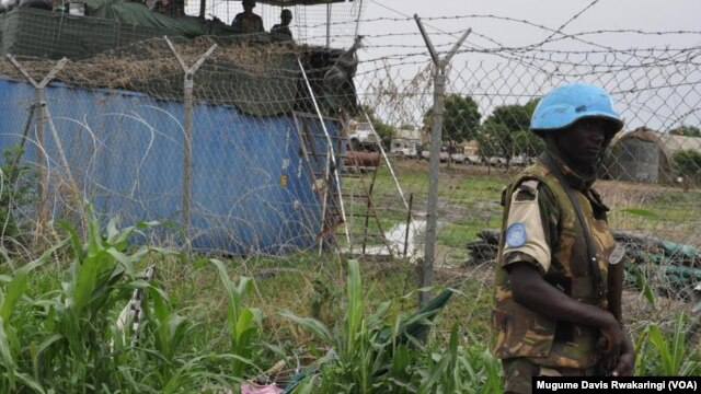 A U.N. peacekeeper stands guard outside the UNMISS compound in Malakal, where thousands of displaced persons are sheltering.