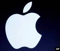 The Apple logo is projected during an announcement in San Francisco.