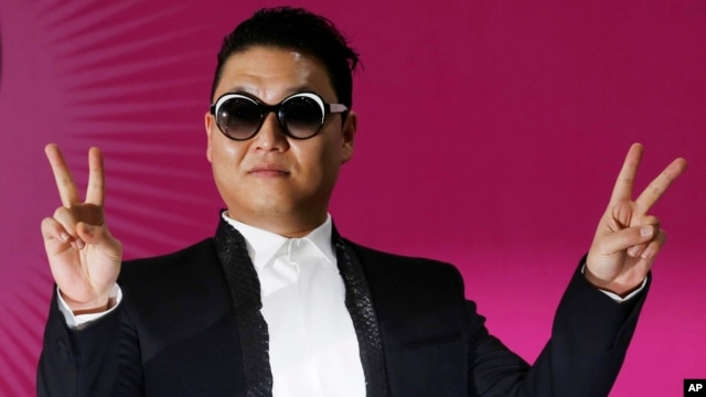 South Korean rapper PSY poses during a news conference for his concert
