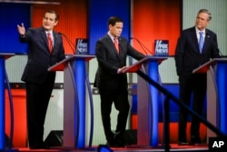 From left, Republican presidential candidate Sen. Ted Cruz answers a question as Sen. Marco Rubio and former Florida Gov. Jeb Bush listen during a primary debate in Des Moines, Iowa, Jan. 28, 2016.