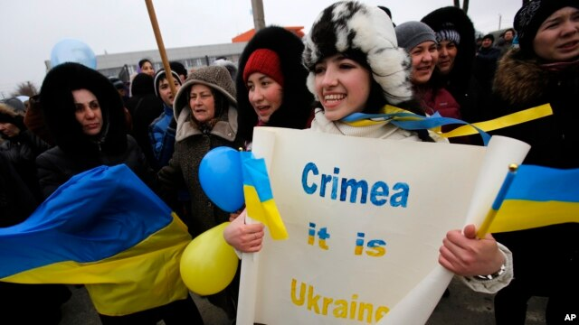 Crimean Tatars shout slogans during the pro-Ukraine rally in Simferopol, Crimea, Ukraine, March 10, 2014.
