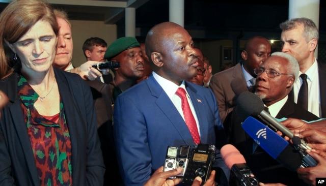 FILE - Burundi's President Pierre Nkurunziza, center, and U.S. ambassador to the U.N. Samantha Power, left, speak to the media in Gitega, Burundi, Jan. 22, 2016.