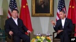 Le président Barack Obama (à dr.) et son homologue chinois ont abordé toute une gamme de questions, dont le cyberespionnage