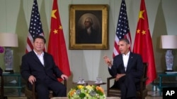 President Barack Obama, right, meets with Chinese President Xi Jinping at the Annenberg Retreat at Sunnylands, June 7, 2013, in Rancho Mirage, California.