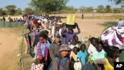 Civilians fleeing violence seek refuge at the UNMISS compound in Bor, capital of Jonglei state, in South Sudan on Dec. 18, 2013.