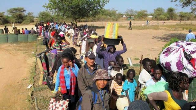 Civilians fleeing violence seek refuge at the UNMISS compound in Bor, capital of Jonglei state, in South Sudan.