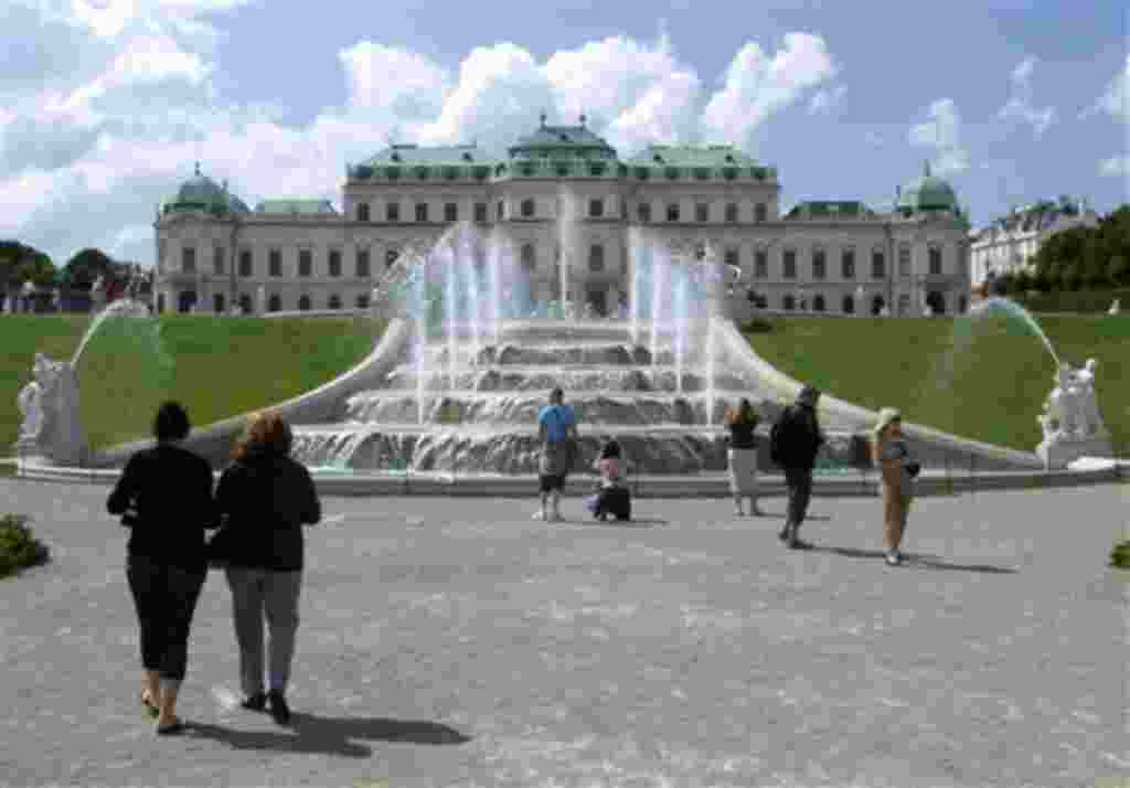 FILE - In this June 24, 2010 file picture tourists enjoy the sunny weather in front of Vienna's Belvedere Palace in Vienna, Austria. Vienna has the best living standard in the world - and Baghdad the worst, according to a consulting group that annuall