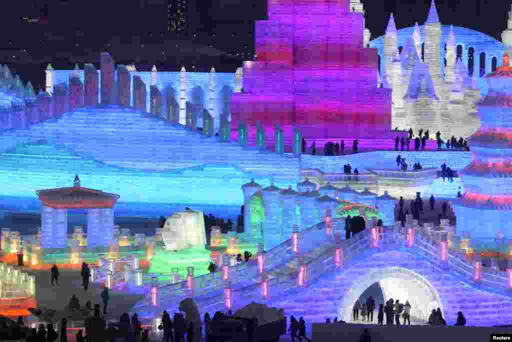People visit illuminated ice sculptures at the Ice and Snow World park ahead of the Harbin International Ice and Snow Sculpture Festival, in Harbin, Heilongjiang province, China, Dec. 23, 2018.