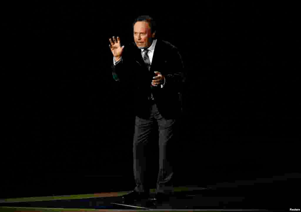 Billy Crystal pays tribute to Robin Williams during the 66th Primetime Emmy Awards in Los Angeles,  Aug. 25, 2014.